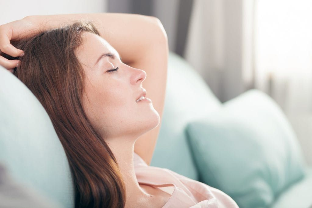 woman sleeping with her head elevated