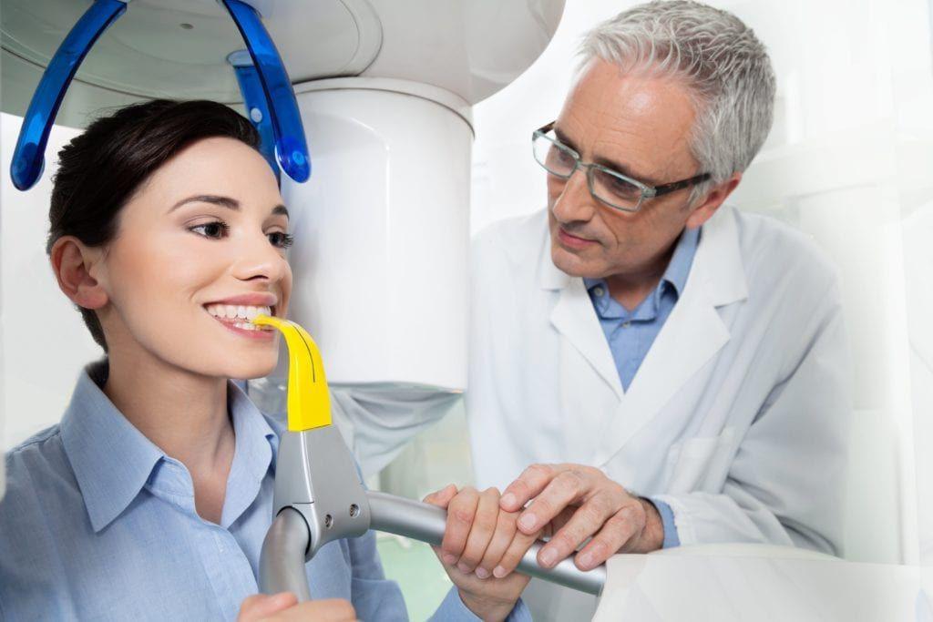 woman having a dental CBCT scan